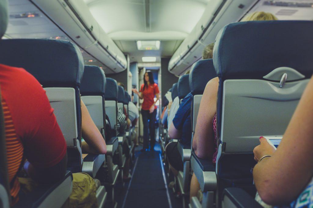 Flight attendant serving to passengers a travel job