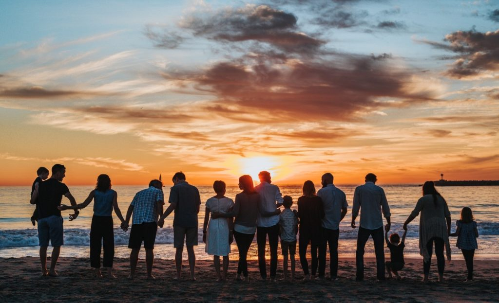 Family photo at beach sunset view